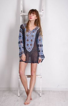 I like this lovely knit blue tunic,  crochet ethnic Ukrainian tunic very much! Its colourful folk style makes this crochet lace tunic quite effective, and unique! The loose construction of this incred