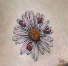 Beautiful daisy tattoo gallery !