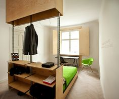 One piece of plywood furniture inside this Polish apartment encompasses a bed, bookshelf, nightstand and wardrobe.