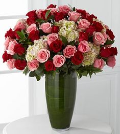Let your heart speak through a dazzling display of blooming beauty. 48 Stems of our finest 24-inch premium long-stemmed roses in blushing shades of pink and red are offset by clouds of soft pink hydrangea, gorgeously situated in a superior clear glass 14-inch bullet vase, to indulge their every sense.