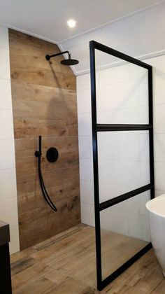 Modern shower tiles in wood look. - Modern shower tiles in wood look. Modern Farmhouse Bathroom, Wood Bathroom, Basement Bathroom, Bathroom Faucets, Small Bathroom, Bathroom Black, Master Bathroom, Wood Tile Shower, Bathroom Ideas