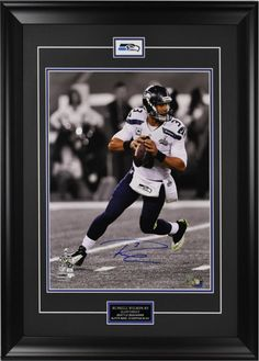You can own this framed Russell Wilson signed photo. We are the place to go for a large variety of the Seattle Seahawks Sports Memorabilia. Check this and other great items out on our website.  #SeattleSeahawks #RussellWilson #NFL #memorabilia #framingstore #vancouver #sports #sportsmemorabilia #framedmemorabilia