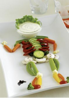 Skeleton and Brain Dip -- Give everyone's sweet tooth a break with this rather jaunty-looking skeleton. The dip is ranch dressing, and those limbs are actually veggies.
