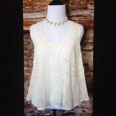 Embroidered Ivory Tank This sheer flowy top displays a delicate flower motif embroidery. Beautiful and casual. Price is firm. Tops Tank Tops
