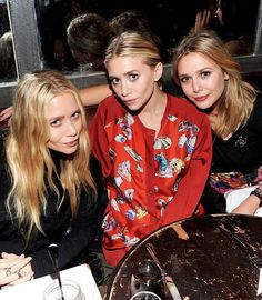 Mary- Kate Olsen,Ashley Olsen and Elizabeth Olsen attend the NYLON & AX Armani Exchange Private Dinner for the October issue with cover star Lizzie Olsen on October 2011 in New York City. Mary Kate Ashley, Mary Kate Olsen, Elizabeth Olsen, Ashley Olsen, Famous Sisters, Three Sisters, Olsen Twins Style, Olsen Sister, Celebrity Siblings