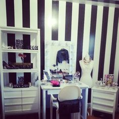 makeup room with black and white stripes all around except for one Tiffany blue wall. :) light bulb...