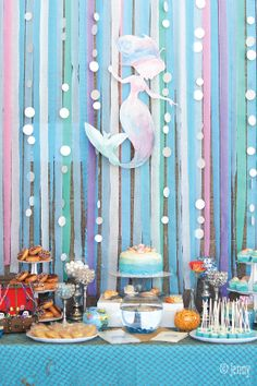 Take your first-birthday party poolside with this fun Mermaid Party theme. With fun snacks like homemade cake pops and a DIY smash cake, blue and purple underwater decor, and shells galore, this party is bound to be the coolest celebration yet. Keep things clean with Bounty Paper Towels!
