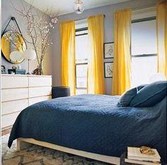 grey walls, yellow curtains, navy bedding