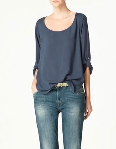 zara blouse $49.90.  I could totally wear this while pregnant if I wanted, though it would change the look a bit.  Excellent.