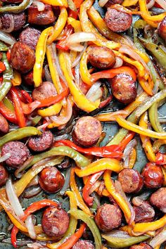 This sheet pan sausage and peppers recipe is simple to make yet full of flavour. It's perfect to eat on its own or pile it high on a hoagie bun. One pan, a few simple ingredients, and you have the perfect lunch or dinner recipe. Vegaterian Recipes, Sausage Recipes, Appetizer Recipes, Dinner Recipes, Cooking Recipes, Healthy Recipes, Dinner Ideas, Sausage And Peppers Recipe In Oven, Sausage Meals