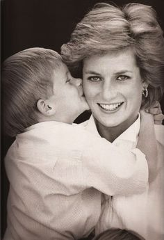 Prince Harry kisses his mother Princess Diana; 1988.