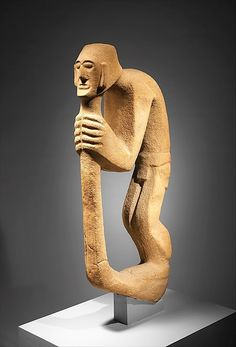 Hunchback figure with staff  Huastec, Mexico  -  10th–12th century