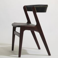 Ten Kai Kristiansen Black Leather Danish Dining Chairs | From a unique collection of antique and modern dining room chairs at https://www.1stdibs.com/furniture/seating/dining-room-chairs/
