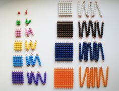 Montessori coloured bead short chains and squares with arrows. The short bead chains and squares forms a part of the Montessori approach to