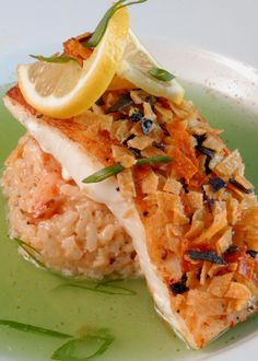 ... Halibut, served with spicy shrimp risotto in a cilantro-lime broth