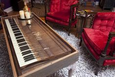 This table was created by taking the keys of an old piano and placing them within a custom made box, which was then attached to four repurposed table legs. By adding a glass top, the see-through surface has become a unique centerpiece as well as a functioning piece of furniture. From DIYnetwork.com