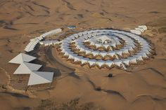 PLaT architects develops lotus hotel in chinese desert