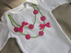 Double strand necklace applique onesie or tee in fushia pink and apple green. $18,00, via Etsy.