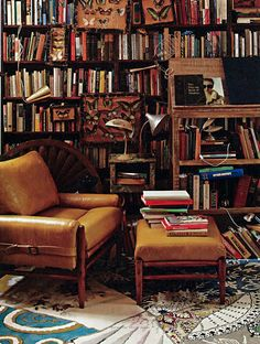 I'm the person who loves to decorate with books.  However, this many books can shrink a room and make it hard to imagine its usefulness.  90% of these books need to be boxed up and stored, add a very select few nic-nacs and keep the shelves clear and clean.  The room will open up, but still have that curl up with a good book feel.
