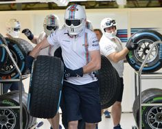 A Williams mechanic gets ready to practice a pit stop