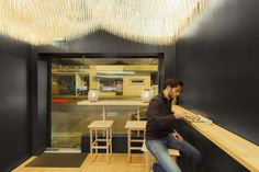 <p>With its 8,400 chopsticks suspended on a ceiling, Basho Sushi House in Porto is a space highlighting the work of a sushi chef. Designed by Paulo Merlini, the bar is only a 25-square-metre space whe