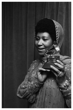 """Aretha Franklin holding her first Grammy Award for """"Respect,"""" 1968."""