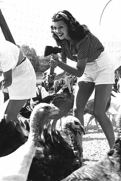 Rita Hayworth looking for the perfect turkey for Thanksgiving, 1939