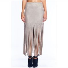 Stone Fringe Maxi Skirt Faux Suede material. Perfectly on trend with suede & fringe! Fits true to size. Available in limited quantity S,M,L. Machine washable! Boutique Skirts Maxi