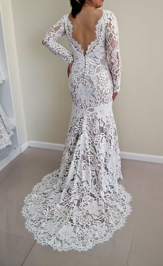 Lace wedding dress with scalloped V-back, scalloped neckline and long sleeves made of stunning couture designer lace.  The wedding dress is