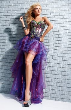 Want to be a Rock star at your next prom? Well we have the perfect dress for you! This divatastic high to low is all about sparkle and glam! T113527 is a rockin' structured mini dress made entirely of beadwork and colored broken glass stones. The skirt is a high to low skirt and can be attached or detached at your will and is sure to impress with its vibrant iridescent chiffon.