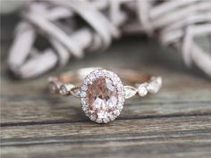 DysonRings!!! Details of the morganite ring: Center Stone: Morganite Stone Shape: 5x7mm Oval Cut Carat Weight: 0.75ct Clarity & Color: VS clarity & Pink in color Accent Stone: Natural Diamonds Shape: Round Cut Total Carat Weight: 0.13ct Clarity & Color: SI clarity & H Custom Order: