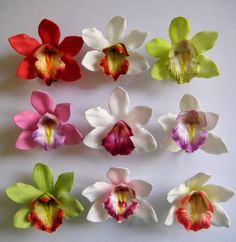 "SET OF 9 Foam Orchid Hair Clips Size: Clusters approx. 3"" ASSORTED COLORS *Perfect complement to any Hawaiian sun dress or outfit. *Great accessories/favors for tropical-theme parties. **Note: Slight variation in color may occur during production process. Reference# 320771032941"