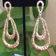 Gold Loop Earrings Great quality these are super fun to wear with anything and everything.  You'll love the hammered look gives it great texture and reflection.  Love the color!!! Approx 3 inches long 1.25 wide 😊 Jewelry Earrings