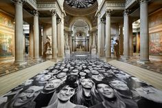 """JR Installs New InsideOut Project """"Au Panthéon"""" in Paris Street artist and French photographer JR was commissioned by the French government to plaster photos of ordinary people throughout the Panthéon, so they may """"enter the temple devoted to illustrious men"""" like Voltaire, Rousseau, Victor Hugo and Émile Zola."""