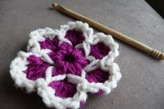 Free Crochet Pattern: Cute as a Button Flower. Rated Easy! From http://www.allfreecrochet.com/Crochet-Flower-Patterns/Cute-as-a-Button-Flower