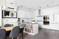 Eclectic Kitchen with Pendant light, Hardwood floors, SE W2D Wall Cabinet with 2 Doors, Ringhult White by Ikea, U-shaped