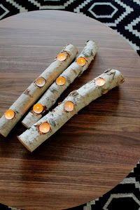 soporte para velas de té realizado con un tronco