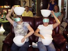 """The Cotton Ball Game' (pictured). """"Two guests (or more) at a time are blindfolded and try to spoon cotton balls from the bowl on their lap into the bowl held on top of their head. They only have 30 seconds to get as many in as possible. It's pretty tough since the cotton balls are almost weightless on the spoon and it's very funny to all the other guests who can see that they are scooping up nothing but air most of the time!"""""""
