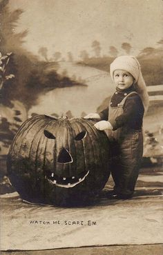 Vintage Halloween portrait with a giant Jack O' Lantern and a little boy. Gorgeous!