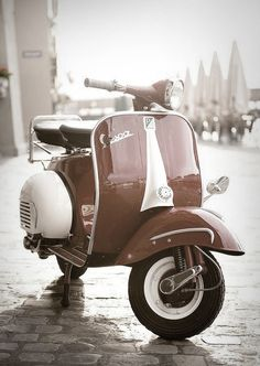 Vespa <3 <3 <3 My dad used to have an old yellow one, just like this. Gotta love the originals...