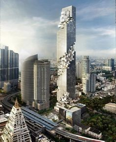 The design of complex Mahanakhon, located in Bangkok, Thailand, has an impressive architecture. The layout of the apartments, and interlaced with clippings in layers, giving the impression that the building is falling apart.  The company Ole Scheeren is responsible for the design of the building, which will have 77 floors. The completion date will be Mahanakhon in 2014.
