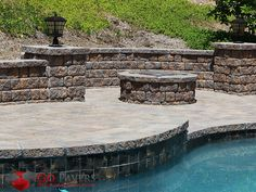 Belgard's Urbana paving stones focus on providing a superior clean-cut stone look that manages to add a significant ambiance to any outdoor space. Paver Fire Pit, Belgard Pavers, West Hills, Pool Coping, Wall Seating, Outdoor Spaces, Outdoor Decor, Paving Stones, Backyard Projects