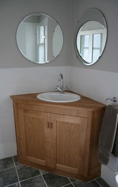 Bathroom Cabinet Stunning Small Corner Bathroom Sink Cabinet From Oak Wood Material With Round Wall Mirrors Also Small Undermount Bathroom Sink In White