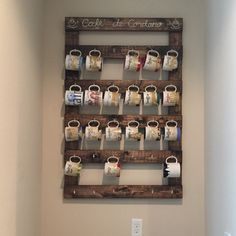Large custom coffee mug rack photo a wonderful customer shared displayed in there home with the Starbucks coffee mug collection from all there travels.