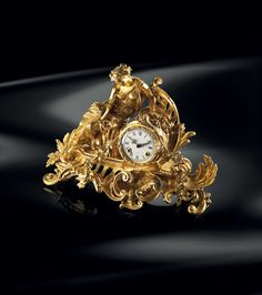 These clocks embody all the opulence and style of Baldi design. Elegant and decorative, they add a touch of personality to every luxury villas. Baldi Paolina clock in gold plated bronze Classic Artwork, Luxury Villa, Luxury Lifestyle, Candlesticks, Clocks, Bronze, Gold Accessories, Jewels, Gemstones