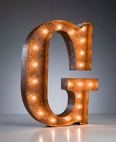 Vintage Marquee Lights - Letter G. $199.00, via Etsy. If this a solution you like we would need to work out some extra electrical into the wall. I couldn't let you have a green cord running down your wall to plug. ;)