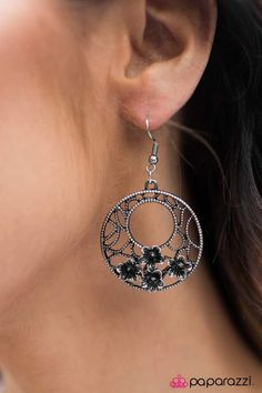 An airy filigree pattern with an aged silver finish swirls around crescent shaped circles. A group of clustered flowers dot the rope textured filigree. With a burnished petal accent, the black rhinestone centers illuminate, creating a dazzling pair of earrings. Earring attaches to a standard fishhook fitting.    Sold as one pair of earrings.