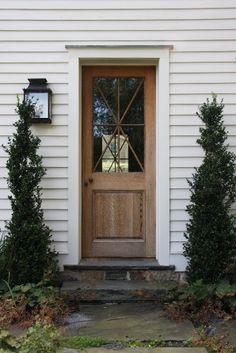 wood door -- warms white exterior -- side door? Décor de Provence: Wednesday Inspirations...