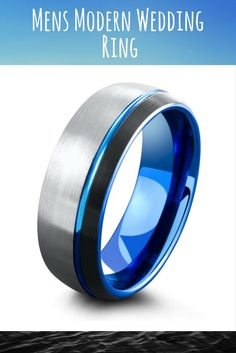 Mens modern wedding ring. This unique mens wedding band is crafted out of tungsten carbide. Blue offset carved channel running though the top of the ring. I love silver, black, and blue combination.