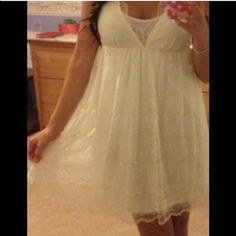 Cream Lace Baby-doll Dress Cream colored lace baby doll dress, looks great with boots or sandals. Wet Seal Dresses Midi